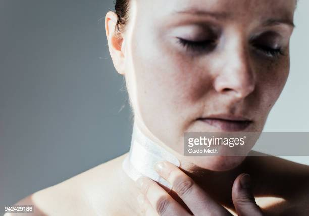 Woman with closed eyes and scar tissue.