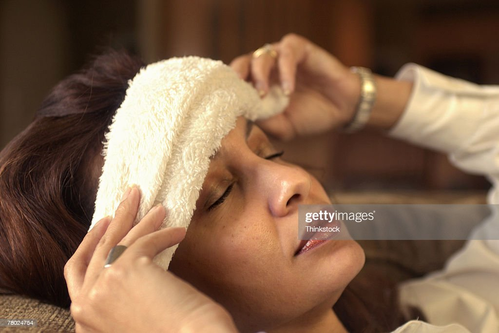 Woman with cloth on forehead : Stock Photo