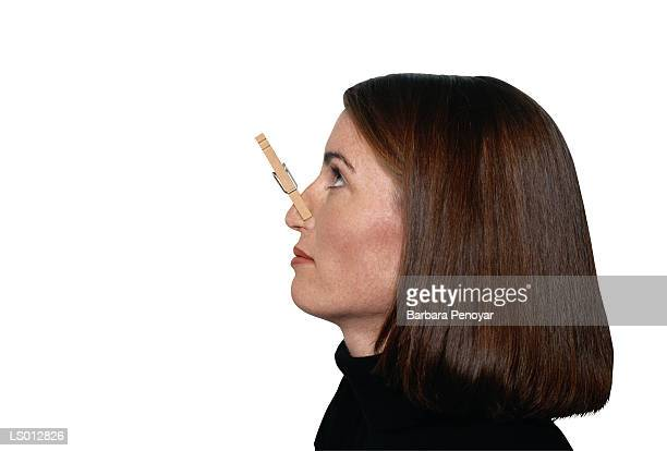 woman with clothespin on her nose - clothespin stock pictures, royalty-free photos & images