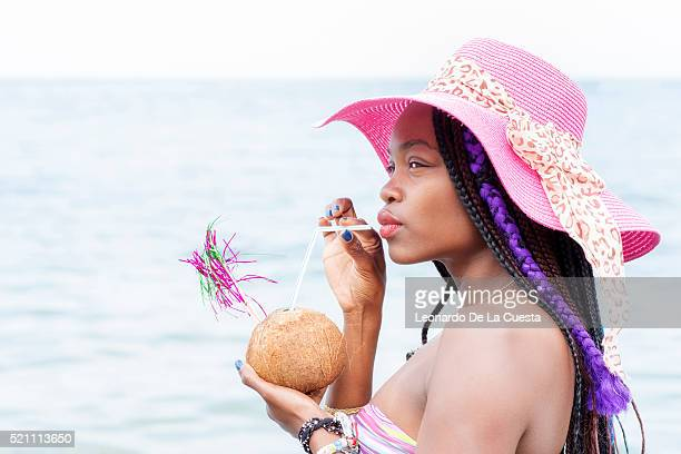 Woman with coconut cocktail.