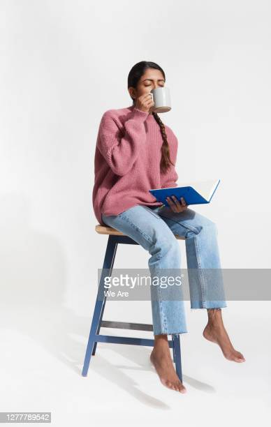 woman with coffee and notebook - tax stock pictures, royalty-free photos & images