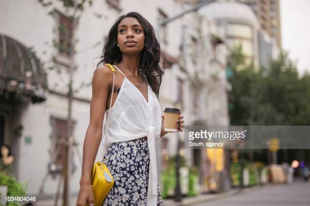 woman with coffee cup - south_agency stock pictures, royalty-free photos & images