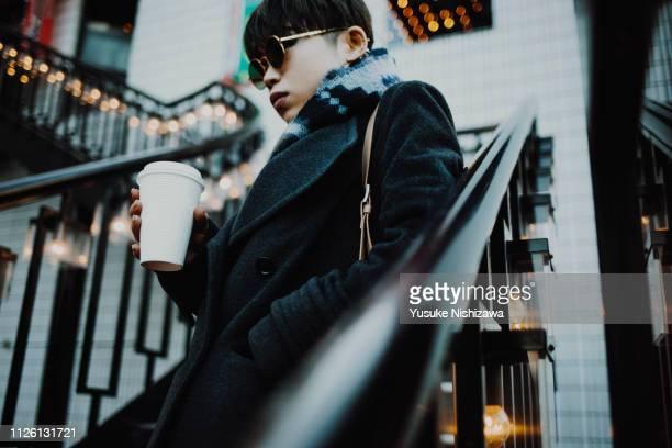 a woman with coffee - yusuke nishizawa ストックフォトと画像