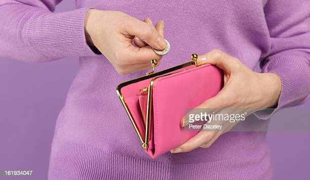 Woman with coin and purse
