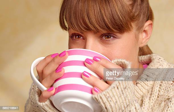 woman with cold and flu drinking soup - jumper stock pictures, royalty-free photos & images
