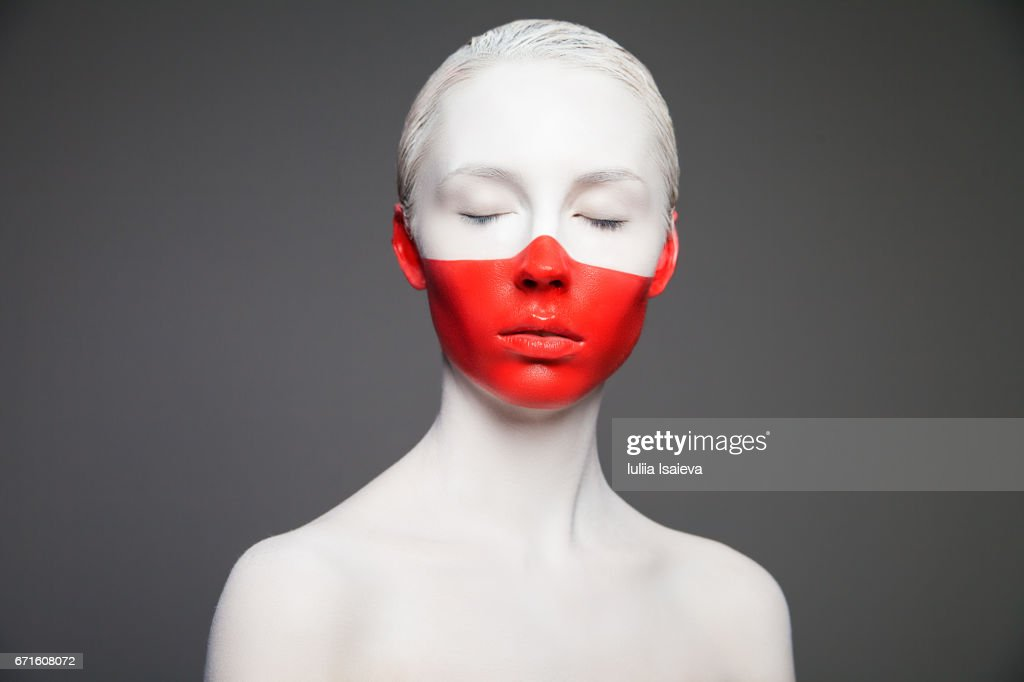 Woman with colorful face : Stock Photo