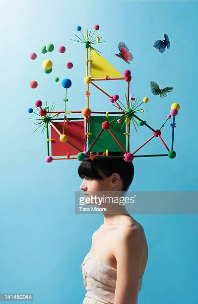 woman with colorful headpiece with balls