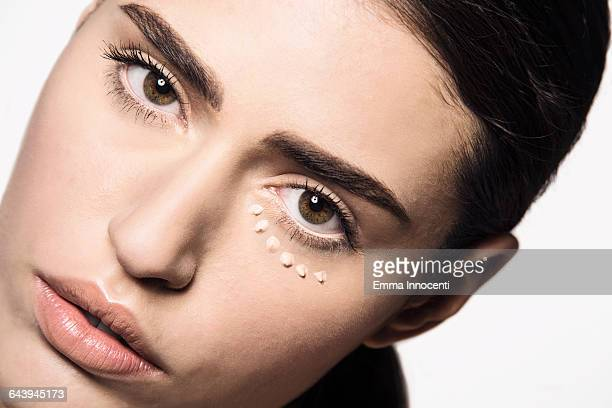 woman with concealer dots under eye