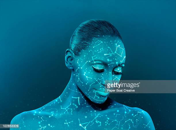 woman with constellations glowing on her face