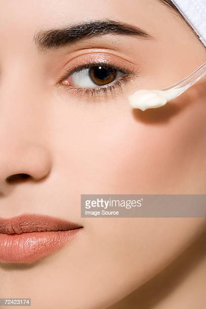Woman with cosmetic cream