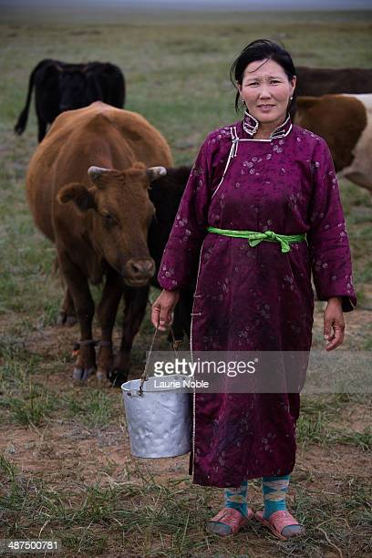 Woman with cow's milk in bucket, Tuv, Mongolia