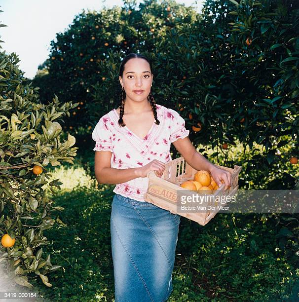 Woman with Crate of Oranges