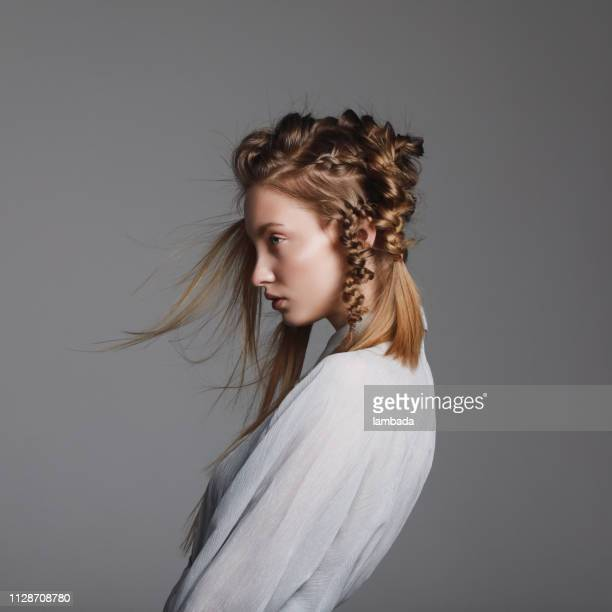 woman with creative hairstyle - hairstyle stock pictures, royalty-free photos & images