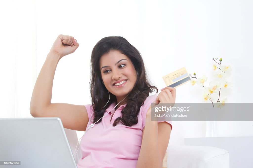 Woman with credit card shopping online : Stock Photo