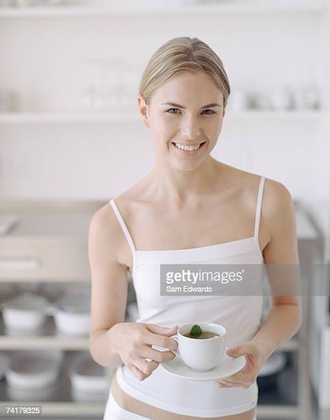 woman with cup of tea - herbal tea stock pictures, royalty-free photos & images