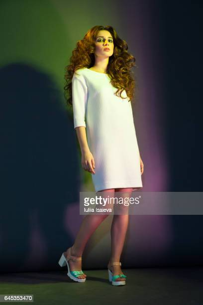 Woman with curls in white dress