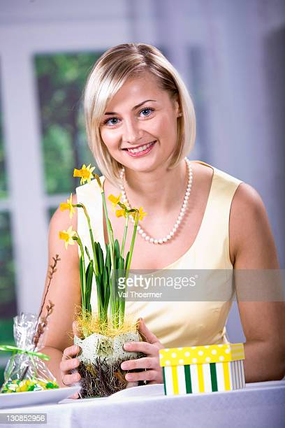 woman with daffodils, easter arrangement - happy resurrection day stock pictures, royalty-free photos & images