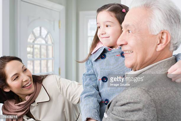 Woman with daughter and father