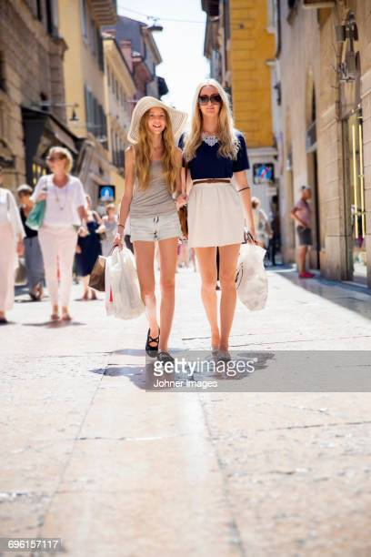 woman with daughter walking in street - girls with short skirts - fotografias e filmes do acervo