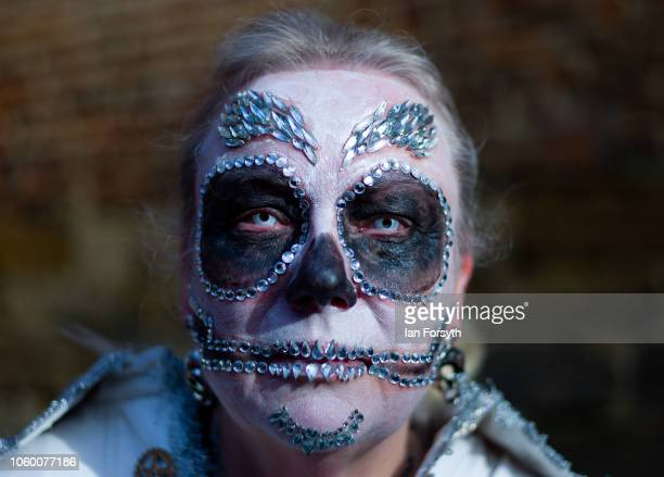 A woman with decorative face make up poses as people take her picture during Whitby Goth Weekend on October 27 2018 in Whitby England The Whitby Goth...