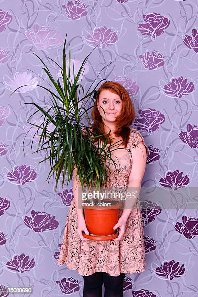woman with decorative plant - ornamental plant stock pictures, royalty-free photos & images