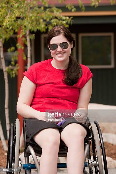 Woman with degenerative hip in a wheelchair