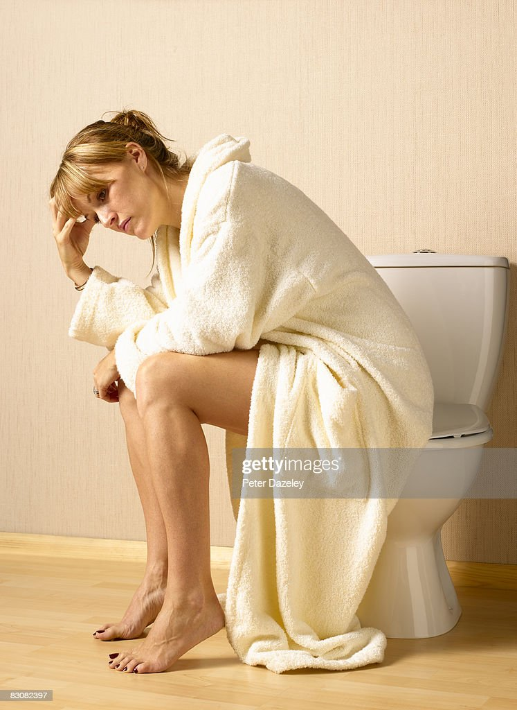 Woman with depression on toilet seat : Stock Photo