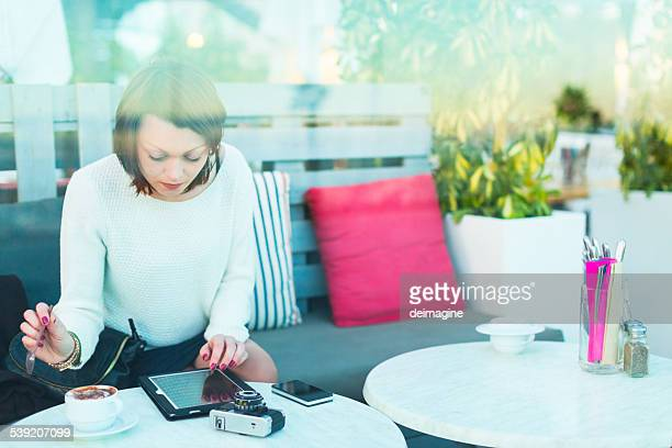 Woman with device during coffee break