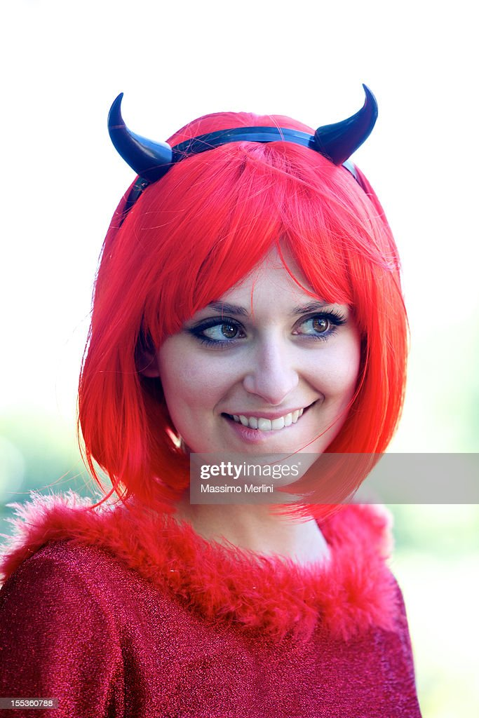 Woman with devil dress : Stock Photo