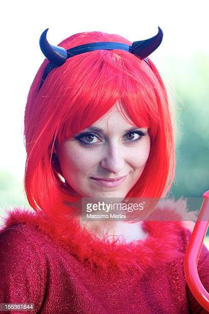 woman with devil dress - devil costume stock photos and pictures