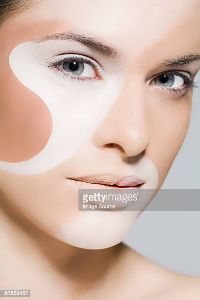 Woman with different colours on her face