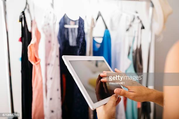 woman with digital tablet in front of wardrobe - red dress fotografías e imágenes de stock