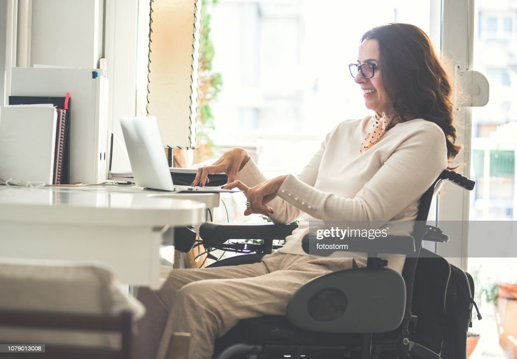 Woman with disability working : Stock Photo