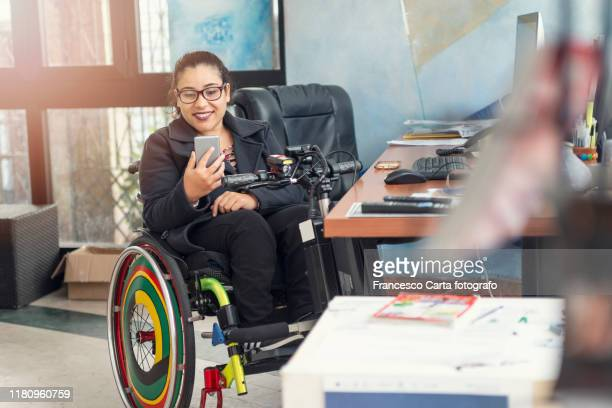 woman with disability working - disabilitycollection stock-fotos und bilder