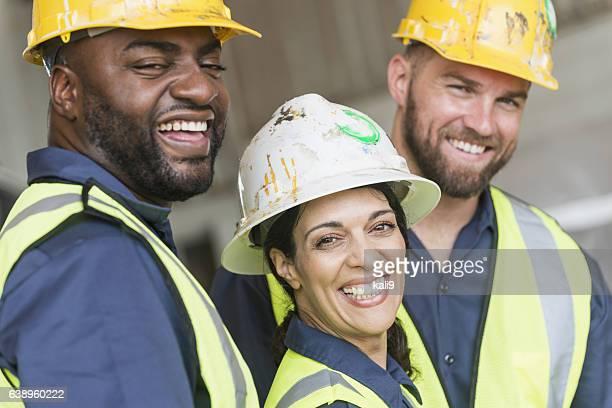 woman with diverse group of construction workers - diverse women imagens e fotografias de stock