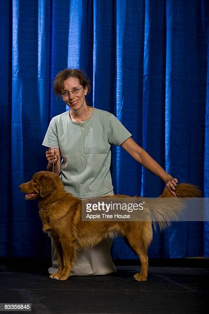 woman with dog at confirmation - dog show stock pictures, royalty-free photos & images