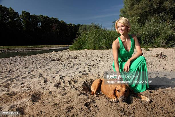 'Woman with dog at River Isar, Munich, Germany'