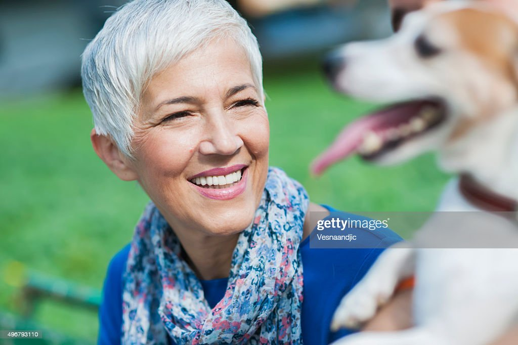 Woman with dog at the city : Stock Photo