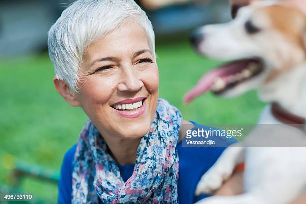 woman with dog at the city - terrier stock pictures, royalty-free photos & images