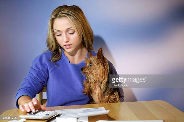 Woman with dog doing finances