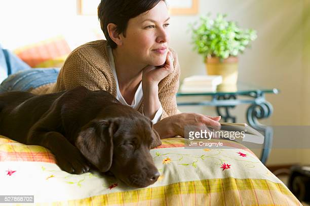Woman with Dog in Bed