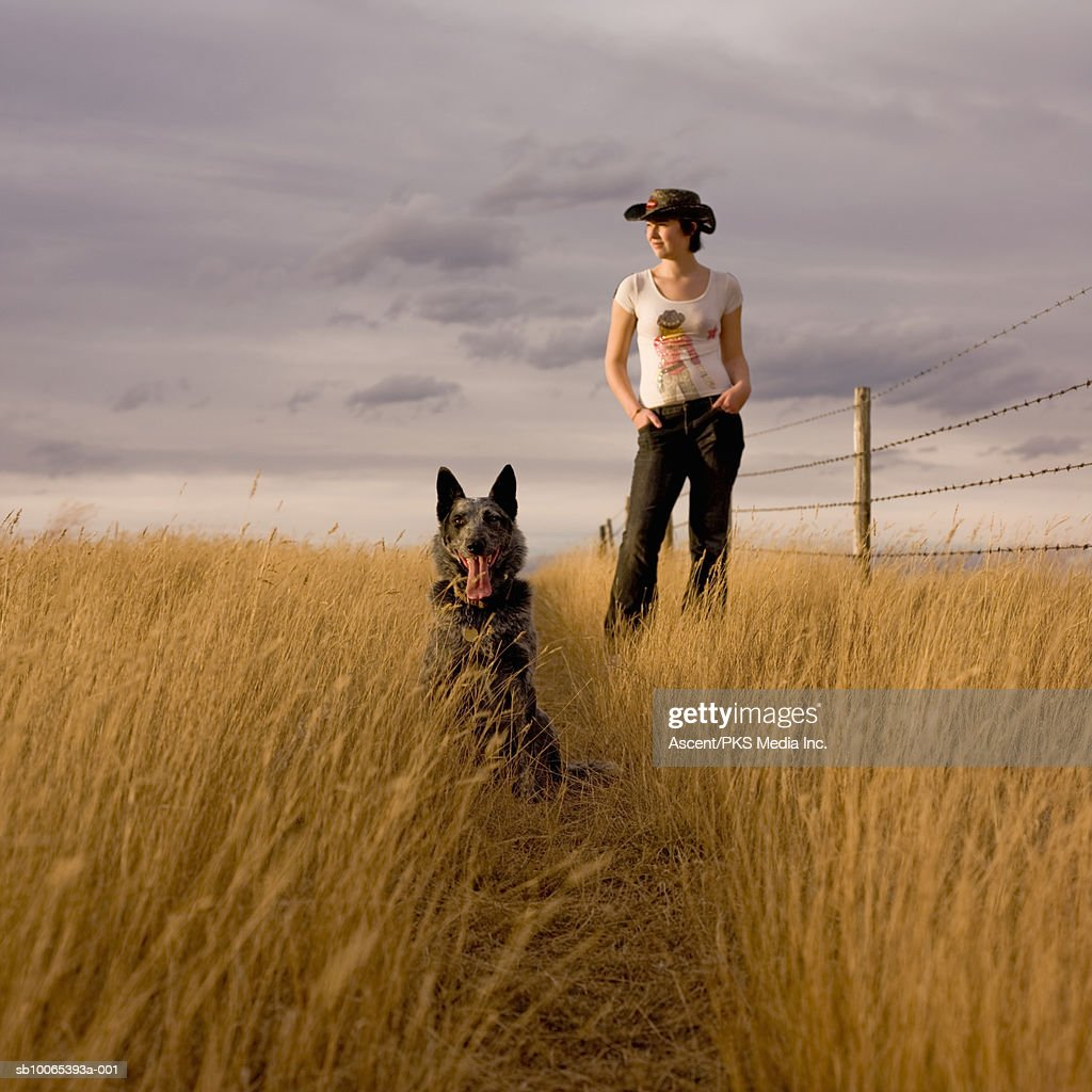 Woman with dog in field : Foto stock
