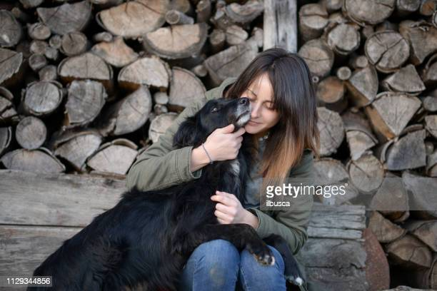 Woman with dog in rural environment