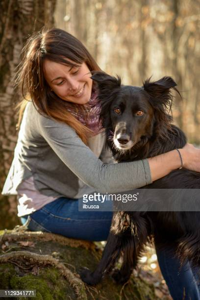 Woman with dog in the forest