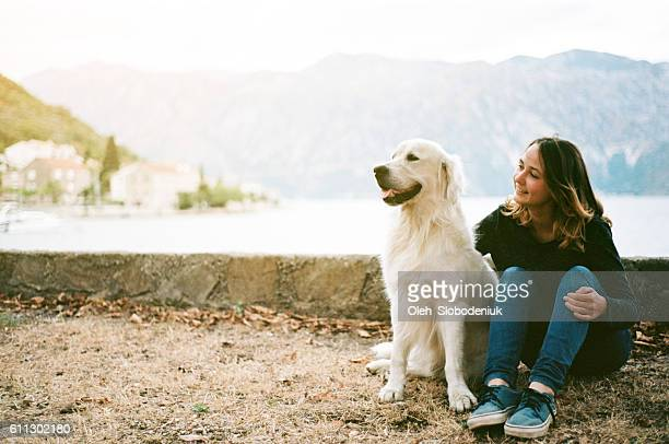 Woman with dog near the Kotor Bay