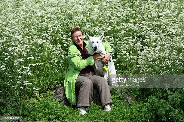 woman with dog - stephan de prouw stock pictures, royalty-free photos & images