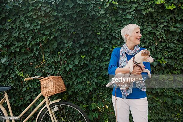 woman with dog - active senior woman stock photos and pictures