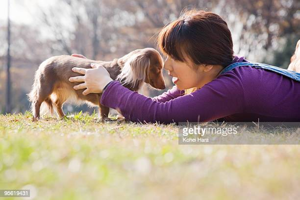 woman with dog - lying on front stock pictures, royalty-free photos & images