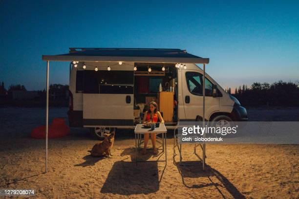 woman with dog sitting near the camper van  on the beach - ukraine landscape stock pictures, royalty-free photos & images