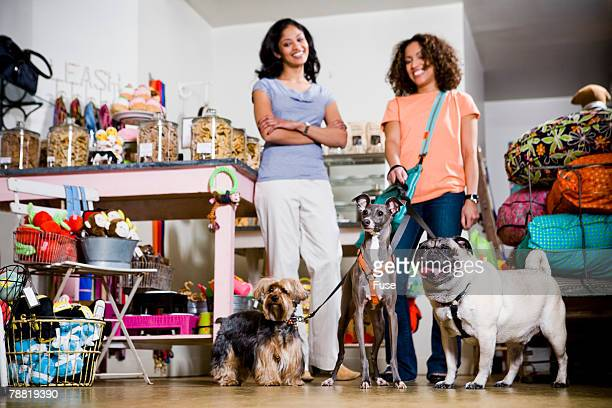 Woman with Dogs in Pet Shop